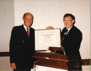 Dr. Laurence Blendis gives Dr. Roger Williams Gold Medal in 1992